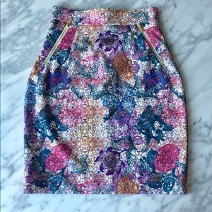 Floral skirt with gold zipper details.
